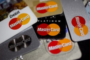 MasterCard Inc. credit and debit cards are arranged for a photograph in Washington, D.C., U.S., on Wednesday, Jan. 29, 2014. MasterCard Inc. is expected to release earnings data on Jan. 31. Photographer: Andrew Harrer/Bloomberg